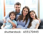 happy family at home  | Shutterstock . vector #655170445