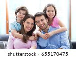 happy family at home  | Shutterstock . vector #655170475
