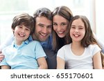 happy family at home  | Shutterstock . vector #655170601
