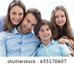 happy family at home  | Shutterstock . vector #655170607
