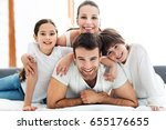 young family in bed  | Shutterstock . vector #655176655