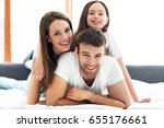 young family in bed  | Shutterstock . vector #655176661