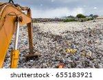 plastic waste dump | Shutterstock . vector #655183921