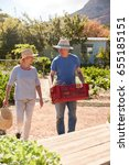 Small photo of Mature Couple Working On Community Allotment Together