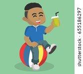 african boy sitting on ball | Shutterstock . vector #655186297