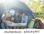family reading the map in tent... | Shutterstock . vector #655191997