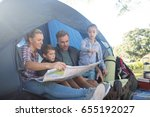 family reading the map in tent... | Shutterstock . vector #655192027