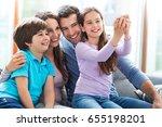 family taking photo of... | Shutterstock . vector #655198201