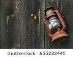 Old Lamp On A Wooden Background