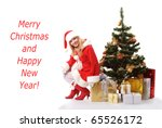 cheerful santa girl sitting on the gift under New-year's tree. Copy text. Christmas greetings card - stock photo