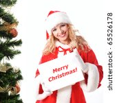 cheerful santa girl hold the blank placard with copy text. Christmas greetings card - stock photo