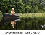 Fisherman Is Sitting In The Ol...