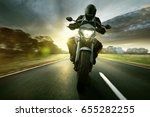 motorbike on a country road | Shutterstock . vector #655282255