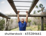 fit man climbing monkey bars... | Shutterstock . vector #655284661