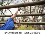 fit man climbing monkey bars... | Shutterstock . vector #655284691