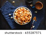 a bowl of popcorn with salted... | Shutterstock . vector #655287571