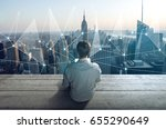 man wtih notebook on a rooftop | Shutterstock . vector #655290649