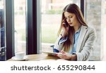 woman holding tablet and...   Shutterstock . vector #655290844
