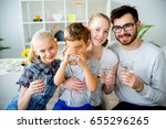 family drinks water | Shutterstock . vector #655296265