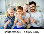 family drinks water | Shutterstock . vector #655296307