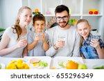 family drinks water | Shutterstock . vector #655296349