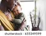 young afro american father with ... | Shutterstock . vector #655349599