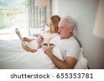 senior man having breakfast on...   Shutterstock . vector #655353781