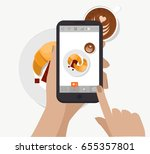 hand holding smartphone and... | Shutterstock .eps vector #655357801
