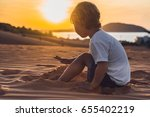 the boy in the red desert at... | Shutterstock . vector #655402219