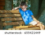 boy with a book in his hand... | Shutterstock . vector #655421449