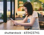young asian woman using smart... | Shutterstock . vector #655423741