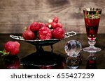 Strawberries On A Glass Table...