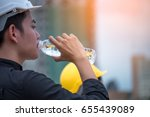 engineers  drinking water. | Shutterstock . vector #655439089