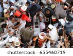 Small photo of PESHAWAR, PAKISTAN - JUN 07: Watermelon juice is being distributing among Muslims as almsgiving by philanthropist during Holy Month of Ramzan nearby Faridabad flyover on June 07, 2017 in Peshawar.