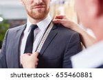 closeup image of tailor taking... | Shutterstock . vector #655460881