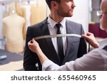 portrait of tailor taking... | Shutterstock . vector #655460965