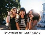 outdoor shot of three young... | Shutterstock . vector #655473649