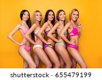 Small photo of Model show, miss beauty contest concept. Diversity of five young attractive ladies, different ethnicity, posing in fancy trendy, fashionable bikinies. So perfect, ideal, healthy bodies