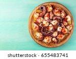 an overhead photo of pulpo a la ... | Shutterstock . vector #655483741