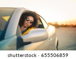 trendy girl driving a sportive...   Shutterstock . vector #655506859