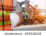 engineer holding white helmet...   Shutterstock . vector #655518235