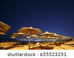 sunshade beach umbrellas... | Shutterstock . vector #655523251