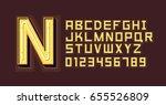 yellow neon light alphabet font | Shutterstock .eps vector #655526809