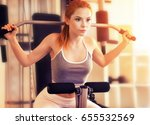 young woman training in gym   Shutterstock . vector #655532569