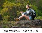 woman backpacker hiking in... | Shutterstock . vector #655575025