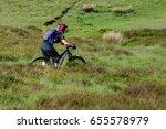 a female mountain biker makes...