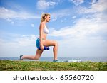 blond female warms up with... | Shutterstock . vector #65560720