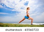 young blond female stretches... | Shutterstock . vector #65560723
