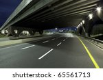 empty freeway at night | Shutterstock . vector #65561713