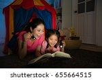 elegant smiling mom with... | Shutterstock . vector #655664515